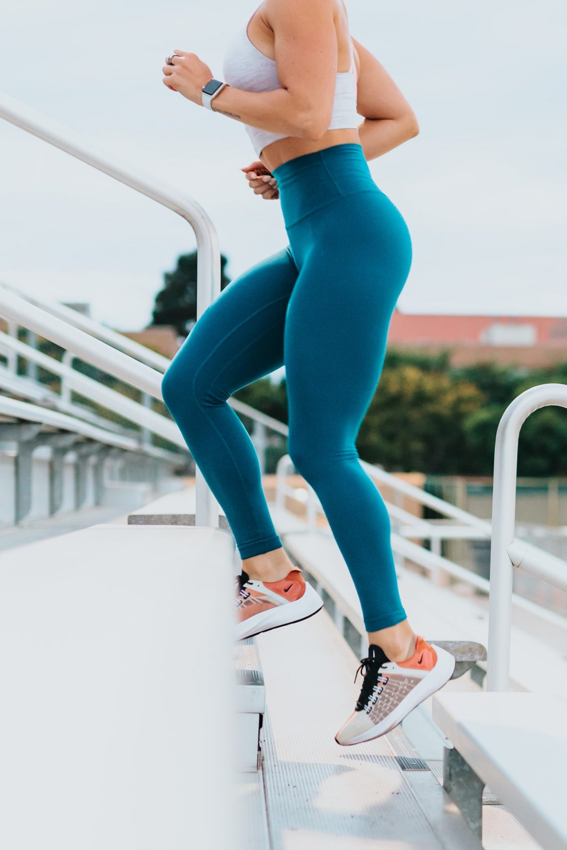 woman running up stairs for workout